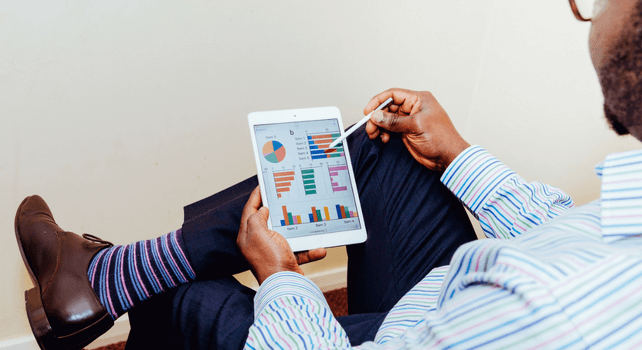 A tablet with charts about digital marketing trends for training providers