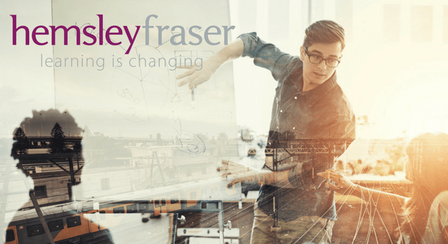 A male employee presenting an overview of Hemsley Fraser's apprenticeships offering
