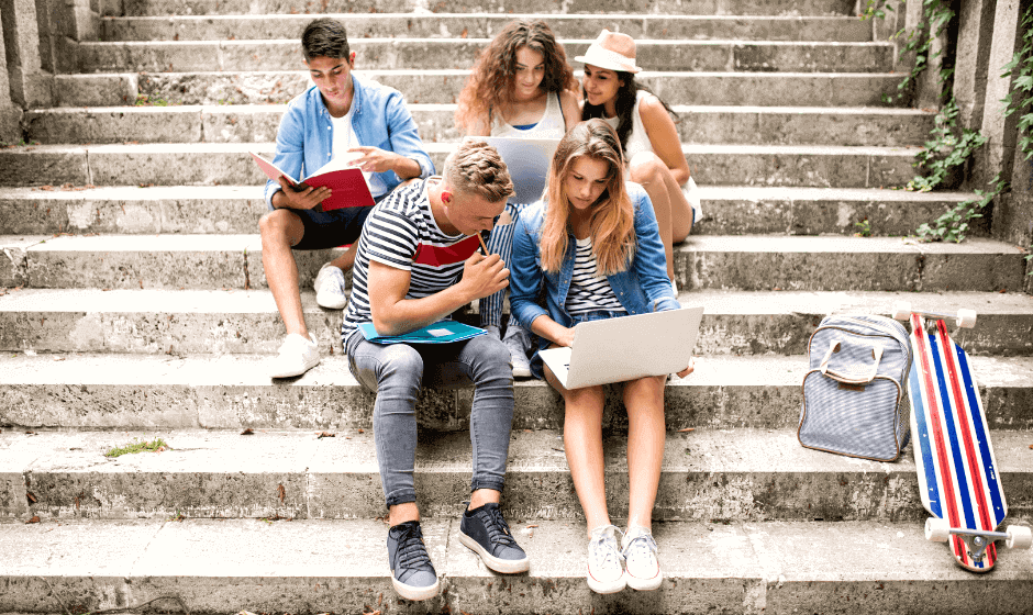 Students sitting and studying on stairs