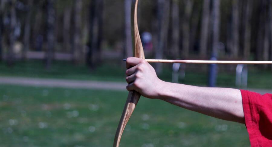 Archer firing arrow