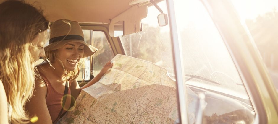 Friends reading a travel map