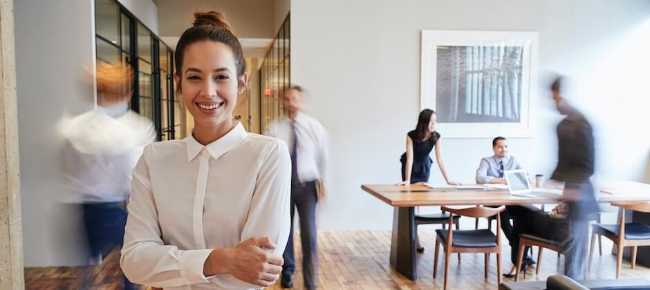 colleagues in office, woman in focus