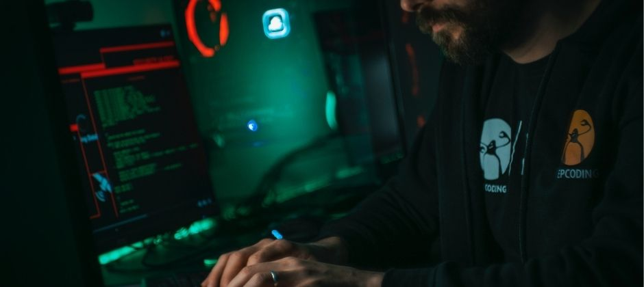 man_coding_in_dark_room