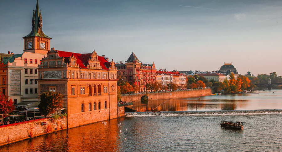 Prague waterfront at sunset