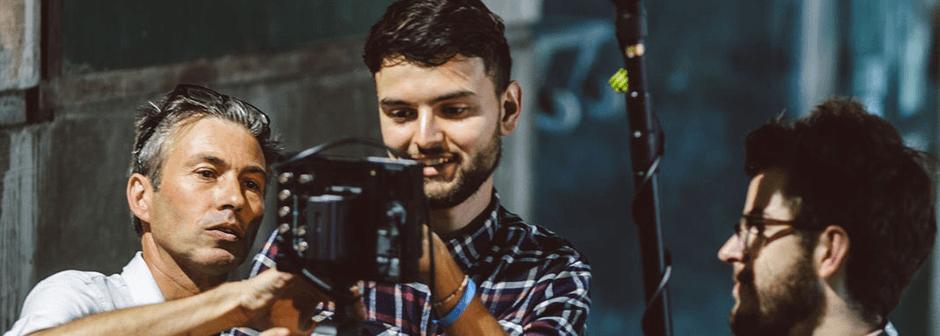 a camera crew of three men