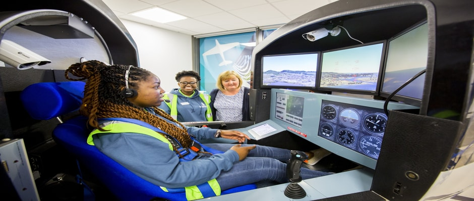 Girl in flight simulator in the College of Engineering, Swansea University