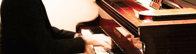 Playing piano - London Piano Institute