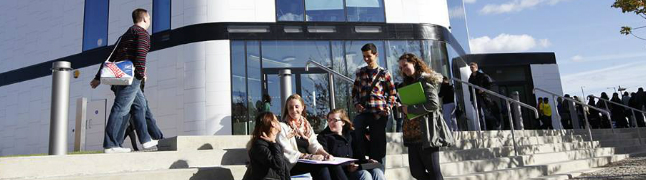 Students sitting on the steps of University of Hertfordshire