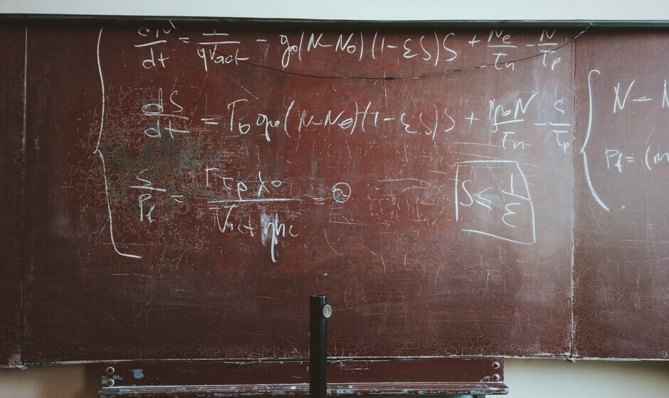 Blackboard with mathematical equation written on it