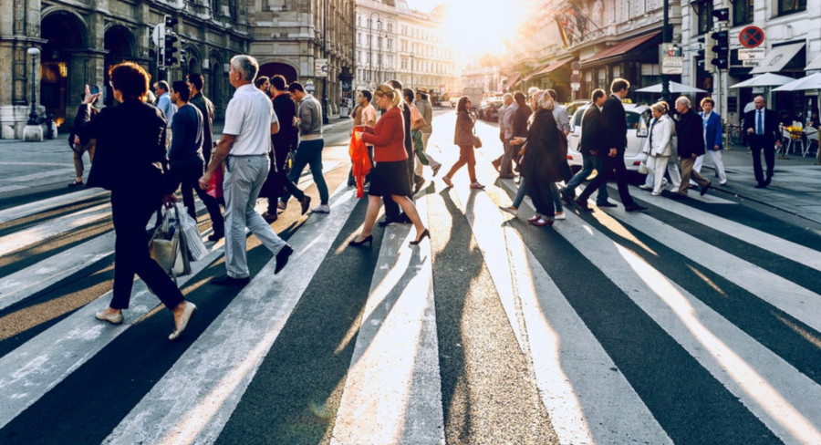 people walking on streets of city