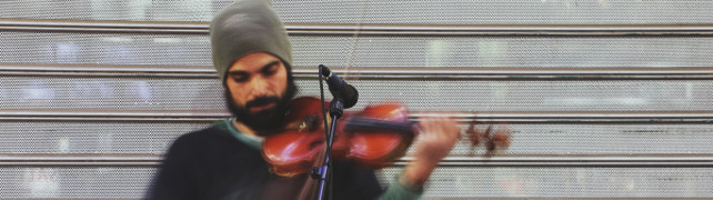 Guy playing a violin
