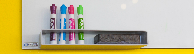 Whiteboard markers and bright yellow wall - gamification